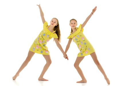 Cute Teen Girls Standing Together and Holding Hands