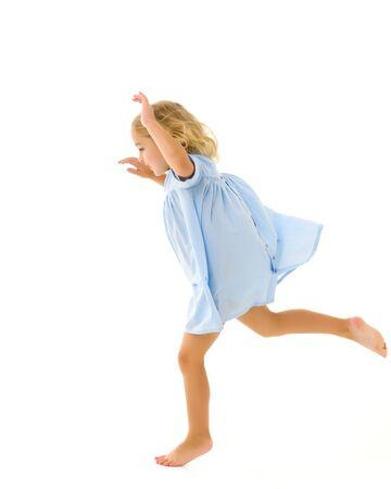 Cute little girl fun running around the room. Childrens games concept Zdjęcie Seryjne