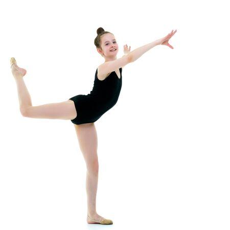 The gymnast perform an acrobatic element. Archivio Fotografico