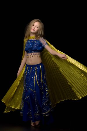 Beautiful Long Haired Girl Dancing Belly Dance with Wings Standard-Bild