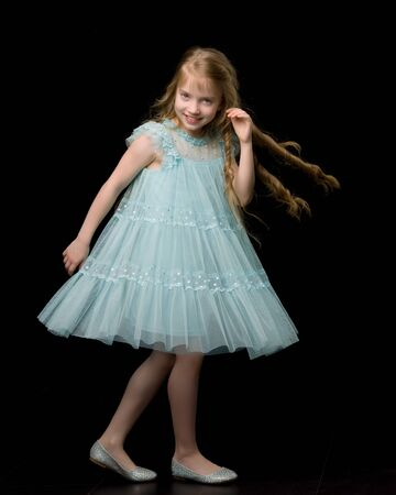 A cheerful little girl is dancing.The concept of a school of dan