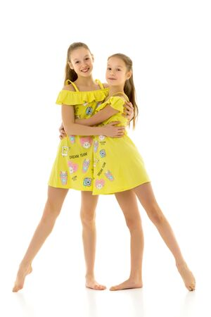 Beautiful Barefoot Teen Girls Standing Together and Hugging