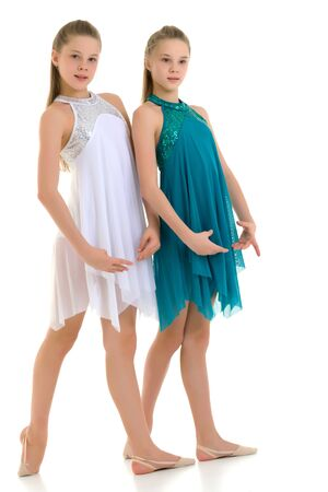 Two Twin Sisters Dancing Wearing White and Blue Sport Dresses Banque d'images