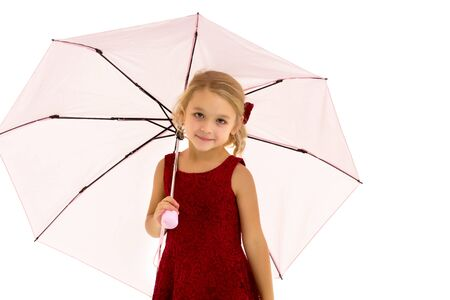 Little girl under an umbrella.Concept style and fashion. Isolated on white background.