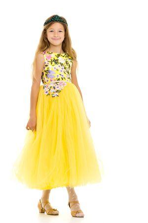A little girl in a long, elegant dress of a princess.