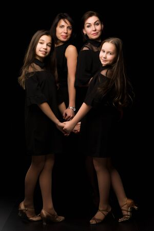 Young, Beautiful mothers with two charming daughters. Studio por