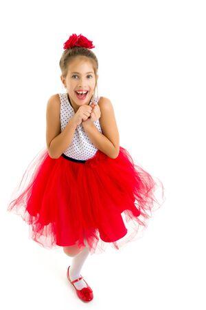 Charming little girl laughing happily in studio Foto de archivo