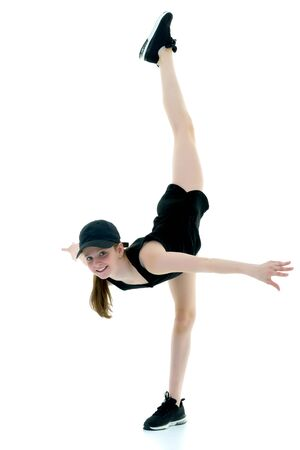 A teenage girl is engaged in fitness.The concept of childrens sports, fitness.