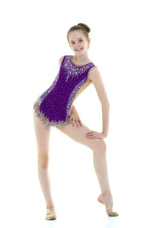 Little girl gymnast in a sports swimsuit.