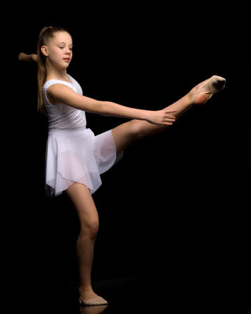 Full length portrait of a charming gymnast girl in elegant dress. Banque d'images