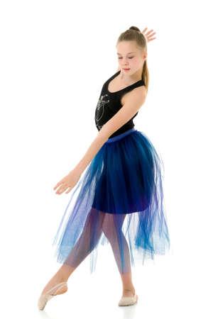 Teenage Girl Gymnast Standing on Tiptoe and Looking to the Side.