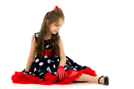 Pretty Girl Wearing Polka Dot Dress Sitting on the Floor