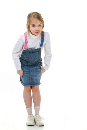 Little girl in a short denim dress. Banque d'images