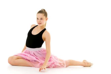 Blonde Girl in Stylish Tulle Dress Sitting on the Floor on her Knees. Foto de archivo