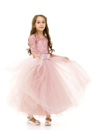 Little girl in an elegant dress.The concept of a happy childhood Foto de archivo