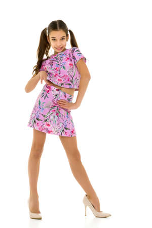 Cheerful little girl in large shoes taken from her mother. Stockfoto