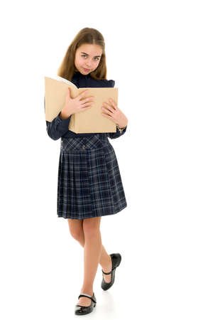 Girl schoolgirl with book.Isolated on white background.