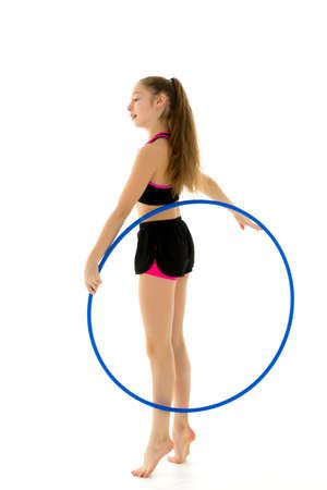 Side View of Gymnast Girl Doing Vertical Splits with Hoop 写真素材