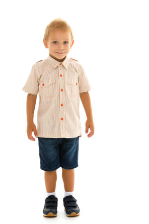Handsome little boy in full growth on a white background. The concept of advertising, happy childhood.