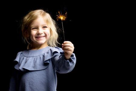 Charming Girl in Nice Blue Dre Holding Burning Sparkler