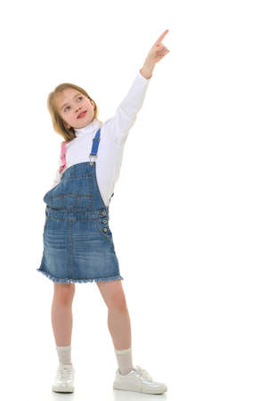 Little girl is showing a finger.The concept of advertising goods and services. Stock Photo