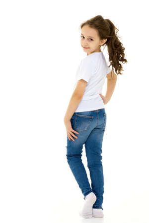 Pretty Stylish Girl with Ponytail Standing with Hands on Her Waist.