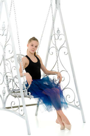 Portrait of Beautiful Teenage Girl Sitting on Elegant Metal Swing. 免版税图像