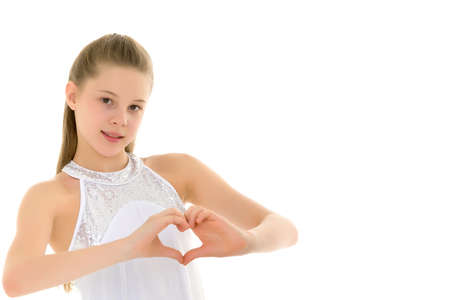 Little girl shows heart with her hands. Stock fotó