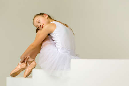 Girl ballerina puts on pointe shoes. The concept of dancing. Stock fotó