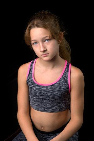 Portrait of cute sporty teenage girl