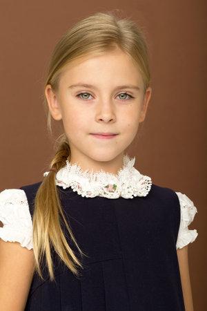 Cute cheerful schoolgirl in uniform
