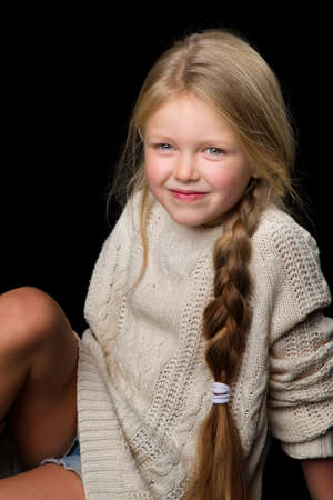 Portrait of beautiful girl sitting on the floor Reklamní fotografie