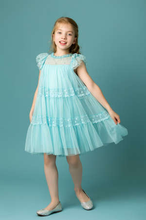 Little girl in an elegant dress.The concept of a happy childhood