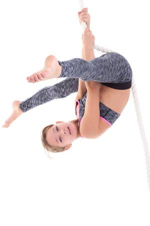 Girl flipping upside down on rope Zdjęcie Seryjne