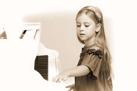 Talented girl playing piano at music lesson