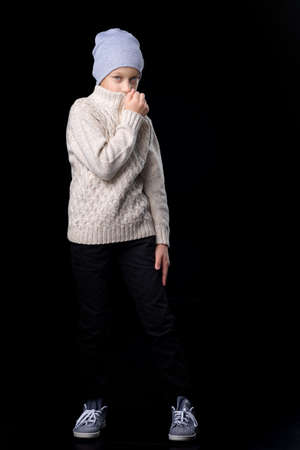 Portrait of cute teenage boy. Photo session in the studio