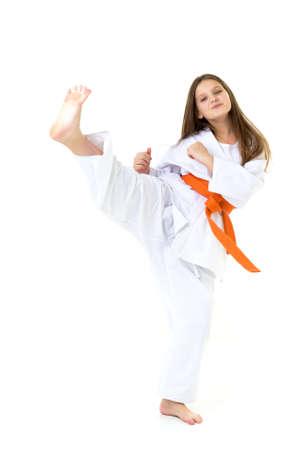 Happy girl in kimono training karate