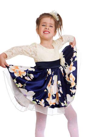 Charming girl holding the hem of her dress Archivio Fotografico