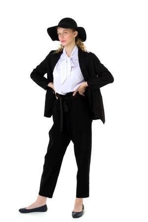 Elegant beautiful girl in a fashionable black suit Фото со стока