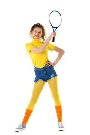 Happy sports girl tennis player posing with racket