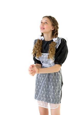 Smiling dreamy teen girl in retro school uniform