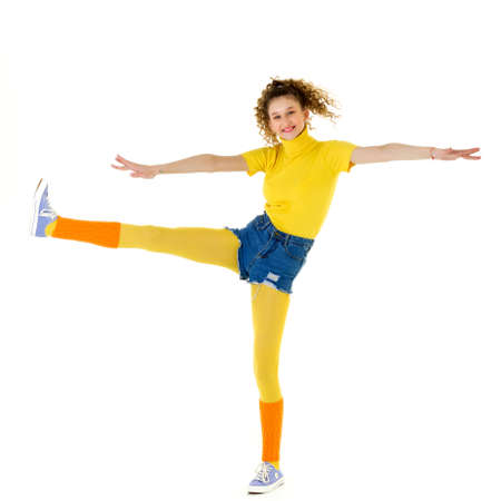 Happy smiling fitness girl standing on one leg