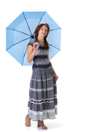 Beautiful woman walking under umbrella Фото со стока