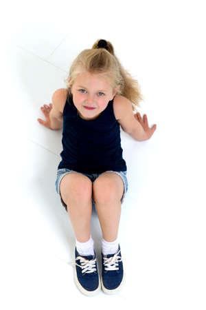 Cute six years old girl sitting on floor