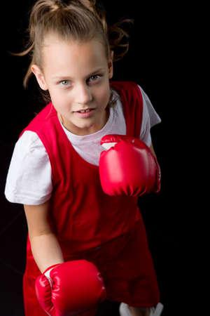 Sporty teenage girl doing boxing exercises