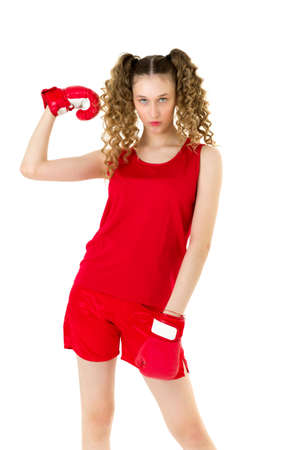 Teen girl in red boxing gloves showing her biceps