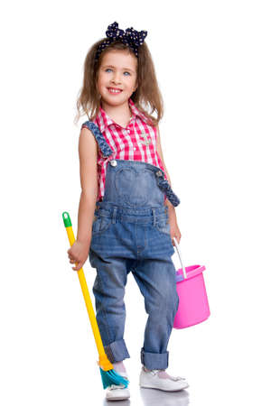Adorable little girl in denim overalls