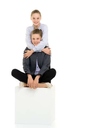 Teenage Girls in Stylish Outfit Posing Against White Background Фото со стока