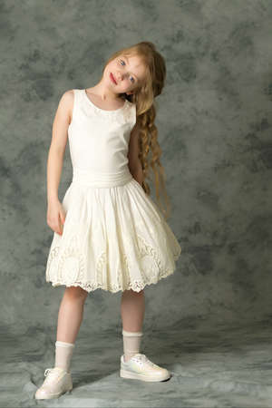 Elegant girl in a dress. Youth fashion concept, happy child.
