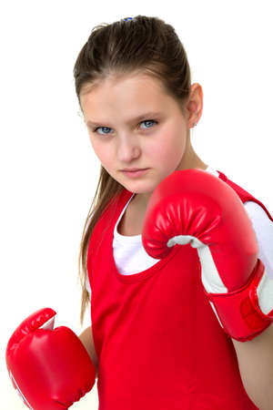 Smiling girl training in boxing gloves Фото со стока